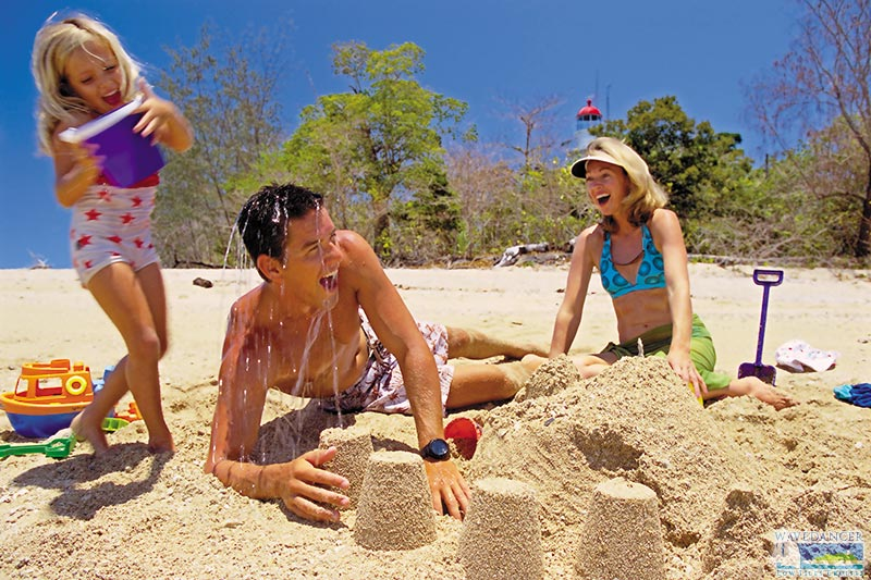 family building sand castle on the beach